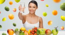 happy woman alkaline food showing water glass